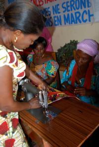 Teaching the women how to sew!