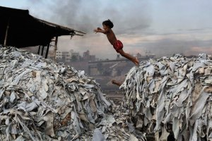 The unglamorous side to fashion: A child jumps on the leather luxury waste products as she plays in a tannery in Dhaka