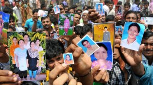 Bangladeshis show photos of missing relatives after building collapse