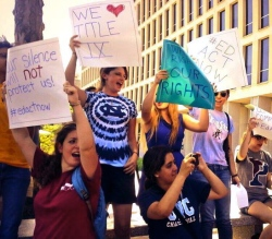 Students protest outside of the Department of Education, demanding better Title IX enforcement (photo courtesy of Feministing).